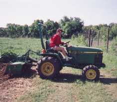 Sara on the John Deere
